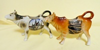 Breslau and Elsenborn souvenir cow creamers