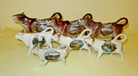 Seven souvenir cow creamers from UK, Belgium and Germany