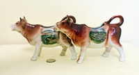 Hohensyburg and Triberg souvenir cow creamers