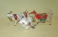 Souvenir cow creamers from Austria, Luxembourg and Switzerland