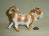 Exmouth souvenir cow creamer, right