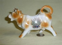 Exmouth souvenir cow creamer, white heather on left