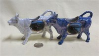 Two German lustre souvenir cow creamers from Guernsey