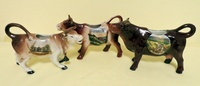 Souvenir cow creamers from Karlsbad, Heidelberg, and Wildemann/Harz