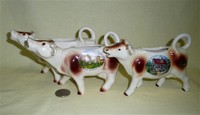 Three German souvenir cow creamers