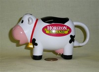 Plastic cow creamer from Horizon Organic, left