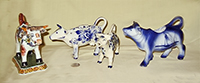 4 misc Delft cow creamers