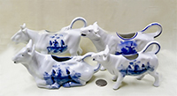 4 German cow creamers with Dutch designs