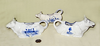 3 German cow creamers with Dutch designs