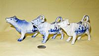 Three small german porcelaon delft cow creamers