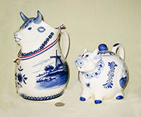 Larghe Delft Cow pitcher and Delst round cow teapot