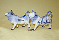 Two Delft cow creamers from similar molds, left