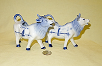 Two Delft cow creamers from similar molds, right