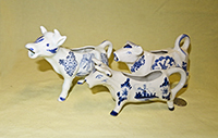 Japanese and unmarked Delft-like cow creamers
