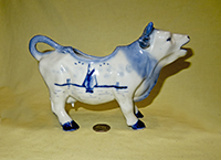 Large stout Delft cow creamer, right