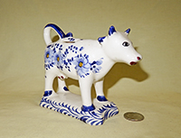 Modern Delft Cow creamer on base, right
