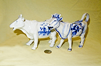 Two Delft cow creamers with raised rt leg