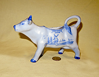 Blue Delft cow creamer by W.H. Sechler, left