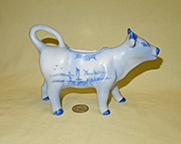 Blue Delft cow creamer by W.H. Sechler, right