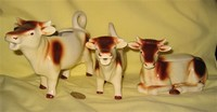 Two brown and white Goebel cow creamers and a sugar