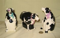 3 Cow caricatrure creamers by Tom Hatton