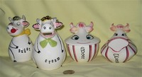 Holt Howard and Lipper & Mann cow creamers and sugars