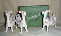 Three Beswick satire mouthless cow creamers