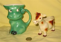 Green Gorbel caricature cow pitcher and large uddered creamer, front