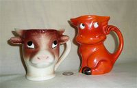 Gorbel cow head and red caricature cow pitchers
