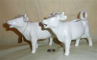 Two matte white Goebel cow creamers