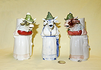 3 Buxom lady in green hat standing S&V cow creamers