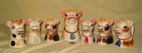 7 Japanese cow head creamers with bells