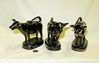 Three Bat-eared Jackfield cow creamers