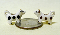 2 black and white V&R cow creamers