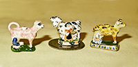 2 V&R Staffordahire cow creamers and a cow figure