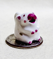Miniature cow creamer with big red nose