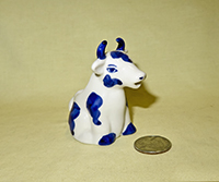 Blue and white sitting cow creamer