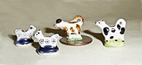 4 miniature cow creamers