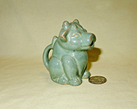 Sitting green cow creamer