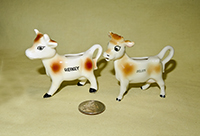 Small Guernsey and Jersey souvenir cow creamers