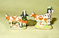 Two V&R cow and milkmaid spill vases