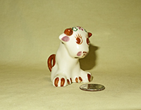 Cute little sitting cow creamer