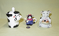 Three miniature cow teapots