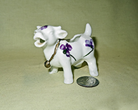 Small porcelain cow creamer with violets