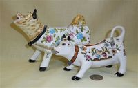 Two Portuguese faience-style cow creamers