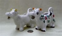Two Portuguese modern caricature cow creamers