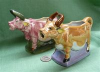 Two pre-WWII Japanese lustre cow creamers on bases