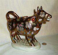 Gold Maitland Smith cow creamer with Chinese decorations