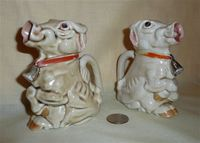 Two ugly German sitting up cow creamers