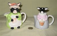 Two 'girl' cow pitchers